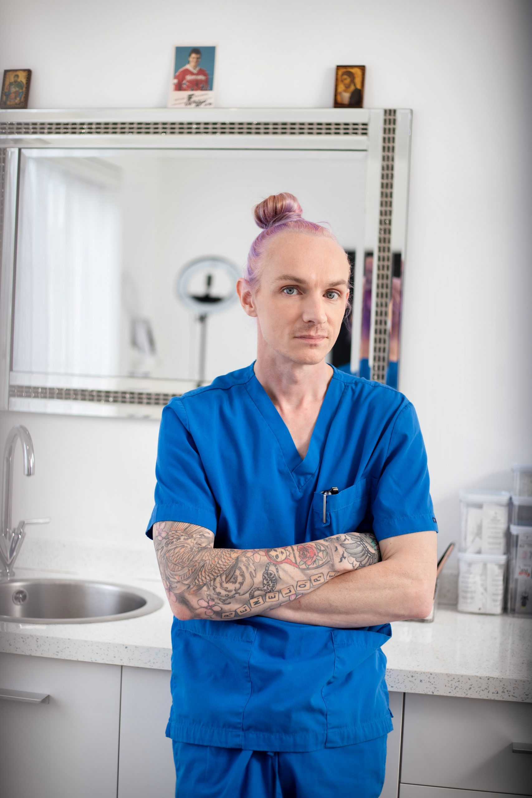 Phil standing in front of a mirror in his treatment room